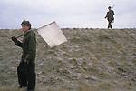 Game bird shoot pheasant shooting  private estate Lancashire England. Boy acting as a beater. 1980s UK