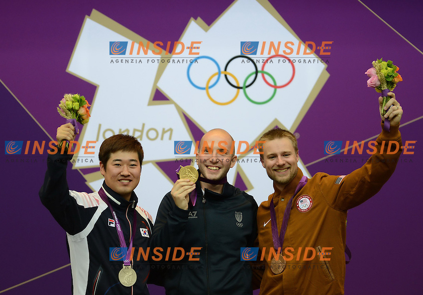 Niccolo Campriani (C) of Italy, silver medalist Kim Jonghyun (L) of South Korea and bronze medalist Matthew Emmons of the United States..Finale Carabina  50m 3 posizioni. Londra 2012 Olympic Games, London, Britain, Aug. 6, 2012..foto Insidefoto /  imago/ Xinhua..ITALY ONLY