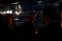 Senator Scott Brown (R-MA) returns to his bus after a campaign rally, the last stop of the day, at the American Civic Center in Wakefield, Massachusetts, USA, on Thurs., Nov. 2, 2012. Senator Scott Brown is seeking re-election to the Senate.  His opponent is Elizabeth Warren, a democrat.