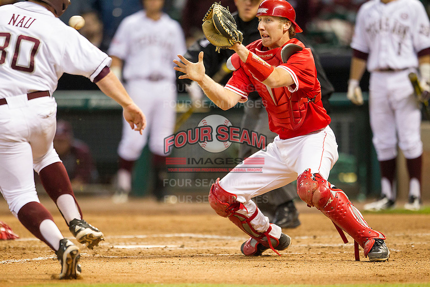 Houston Cougar catcher Caleb Barker #27 prepares to catch the ball as Texas A&M Aggie baserunner Mitchell Nau #3 slides home in the NCAA baseball game on March 1st, 2013 at Minute Maid Park in Houston, Texas. Houston defeated Texas A&M 7-6. (Andrew Woolley/Four Seam Images).