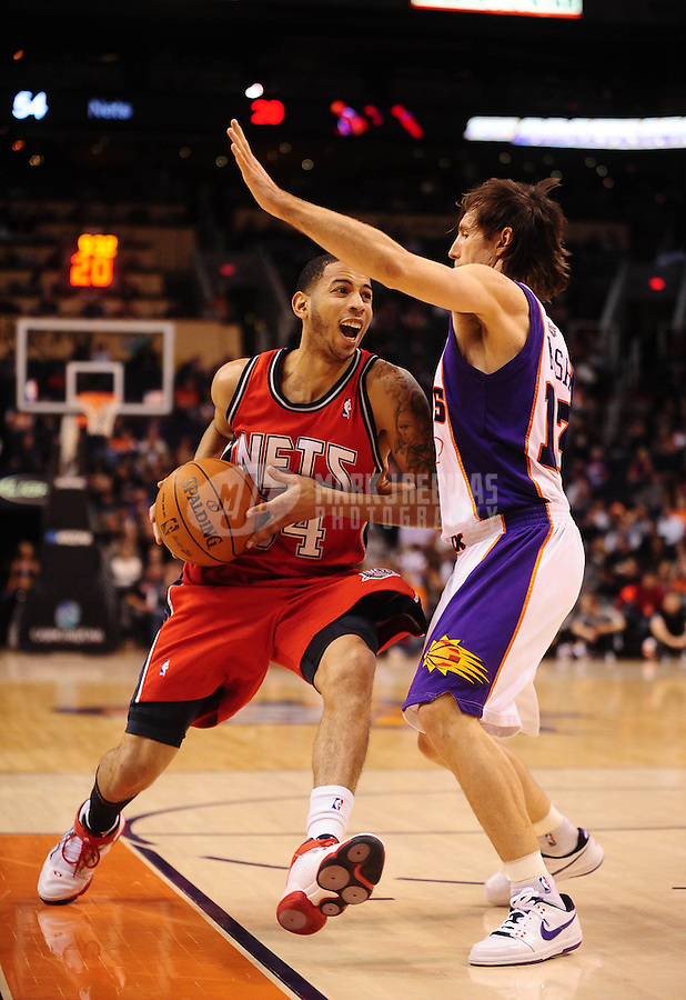 Jan. 20, 2010; Phoenix, AZ, USA; New Jersey Nets guard (34) Devin Harris drives to the basket under pressure from Phoenix Suns guard (13) Steve Nash at the US Airways Center. The Suns defeated the Nets 118-94. Mandatory Credit: Mark J. Rebilas-