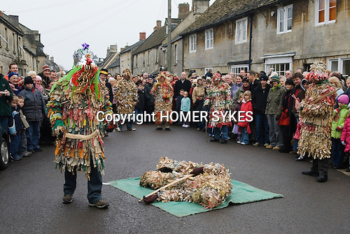 Marshfield Mummers, Boxing Day performance, Gloucestershire, England. 2006. Littel Man John lies slain on the floor by King William with sword.