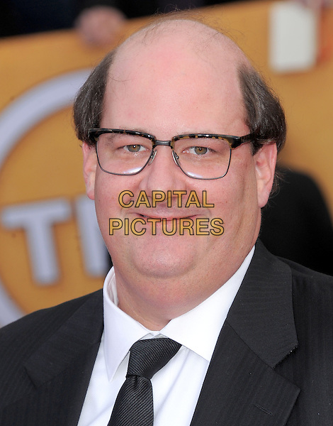 Brian Baumgartner.Arrivals at the 19th Annual Screen Actors Guild Awards at the Shrine Auditorium in Los Angeles, California, USA..27th January 2013.SAG SAGs headshot portrait black white shirt suit tie glasses .CAP/DVS.©DVS/Capital Pictures.