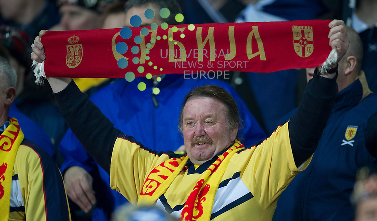 A scotland fans holds up a Serbian scarf during the Fifa World Cup Qualifier between Serbia and Scotland at Stadion Karadorde, Novi Sad, Serbia. 26 March 2013. Picture by Ian Sneddon / Universal News and Sport (Scotland). All pictures must be credited to www.universalnewsandsport.com. (Office) 0844 884 51 22. .