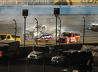 Nov. 7, 2008; Avondale, AZ, USA; Nascar Craftsman Truck Series driver Ron Hornaday Jr (33) crashes as Johnny Benson (23) attempts to miss him during the Lucas Oil 150 at Phoenix International Raceway. Mandatory Credit: Mark J. Rebilas-