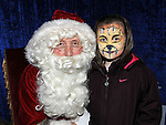 Aoibhín Smith McKenna pictured with Santa at his grotto at the Drogheda Town Centre. Photo: Colin Bell/pressphotos.ie