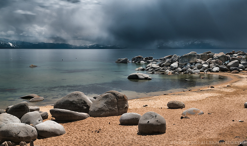 A spring storm moves over Lake Tahoe.  Taken from Speedboat Beach on the North Shore of Lake Tahoe.