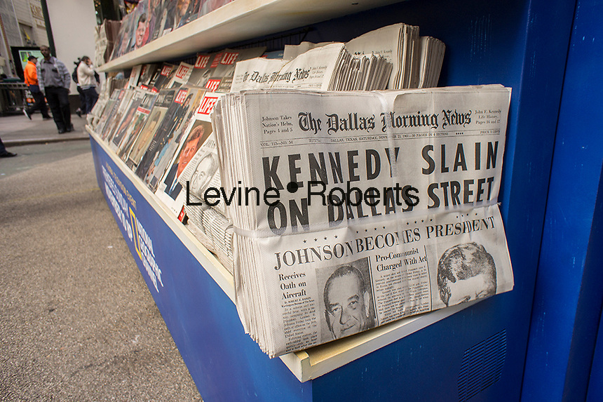 "A 1960's era newsstand, complete with 1963 newspapers and magazines, and contemporarily dressed actors at the promotion for the National Geographic Channel's program ""Killing Kennedy"" , based on the book of the same name by Bill O'Reilly and Martin Dugard, seen in Herald Square in New York on Wednesday, November 6, 2013. The program will premiere on November 10 and November 22, 2013 is the 50th anniversary of the Kennedy assassination.   (© Richard B. Levine)"