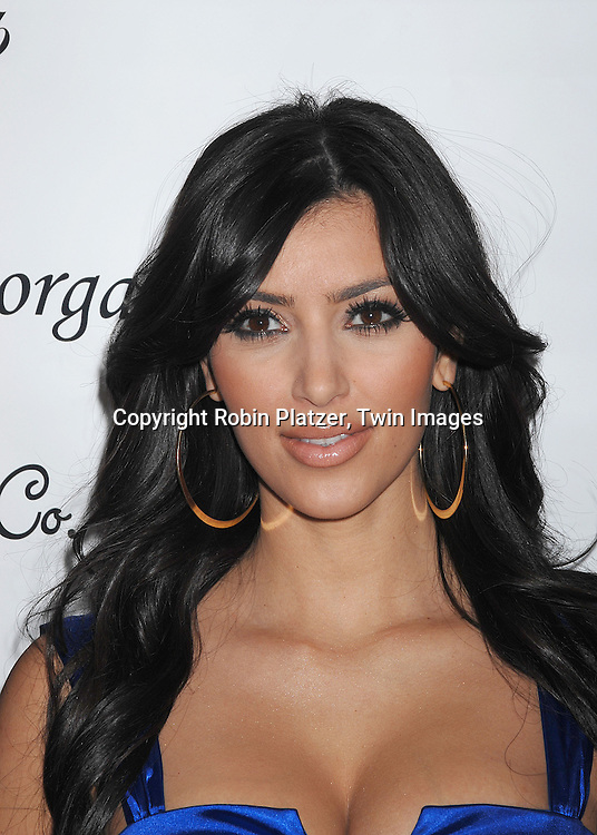 Kim Kardashian..posing for photographers at a party for the new Morgan & ..Company fashion line Morgan 4 Ever on November 7, 2007 at Underbar at the W Hotel in New York. Kim hosted the party...Robin Platzer, Twin Images....212-935-0770