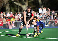 NZ captain Phil Burrows is tackled by Muhammad Amin Rahim during the international hockey match between the New Zealand Black Sticks and Malaysia at Fitzherbert Park, Palmerston North, New Zealand on Sunday, 9 August 2009. Photo: Dave Lintott / lintottphoto.co.nz