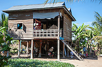 Cambodia.  Typical Rural House, with Living Quarters above the Ground-level Storage Area.