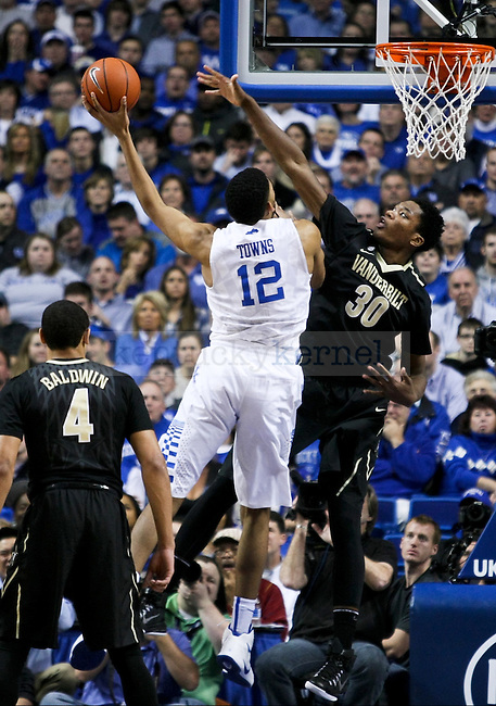 Kentucky forward Karl-Anthony Towns attacks the rim during the First half of the University of Kentucky vs. Vanderbilt game at the Rupp Arena in Lexington, Ky., on Tuesday, January 20, 2015. Photo by Jonathan Krueger | Staff