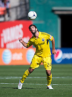 Agustin Viana (24) of the Columbus Crew heads the ball during the game at RFK Stadium in Washington, DC.  Columbus Crew defeated D.C. United, 2-1.