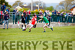 Rathmore Paul Murphy gets his pass away despite being closely marked by Chris O'Leary Kilcummin during the Club Championship clash in Rathmore Wednesday evening