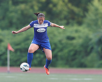 Correction: Boston Breakers defender Cat Whitehill (4) traps the ball at midfield. In a National Women's Soccer League (NWSL) match, Seattle Reign FC (white) defeated Boston Breakers (blue), 2-1, at Dilboy Stadium on June 26, 2013.