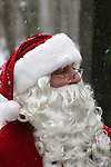 Santa Claus in the woods of the North Pole during winter while it is snowing before Christmas greifenhagen