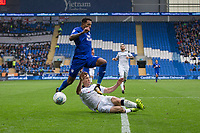 Nathaniel Mendez-Laing of Cardiff City is tackled by Craig Forsyth of Derby County during the Sky Bet Championship match between Cardiff City and Derby County at Cardiff City Stadium, Cardiff, Wales on 30 September 2017. Photo by Mark  Hawkins / PRiME Media Images.