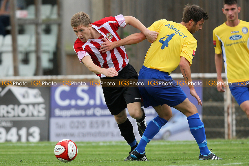 Lewis Smith of Hornchurch evades James Elmes of Concord - AFC Hornchurch vs Concord Rangers - FA Cup 1st Qualifying Round Football at The Stadium - 17/09/11 - MANDATORY CREDIT: Gavin Ellis/TGSPHOTO - Self billing applies where appropriate - 0845 094 6026 - contact@tgsphoto.co.uk - NO UNPAID USE.