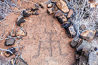 A rock-encircled Hawaiian petroglyph or ki'i pohaku at Puako Petroglyph Park, Big Island.