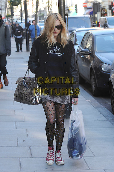 FEARNE COTTON .Leaving BBC Radio 1, London,  England..February 8th, 2011.full length black pattern tights pink converse trainers sneakers all star sunglasses shades silver bag purse plastic shopping sunglasses shades leather jacket grey gray skirt walking .CAP/IA.©Ian Allis/Capital Pictures.