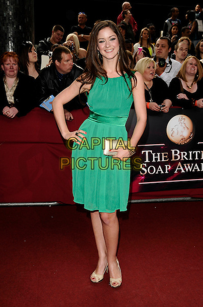 JAKE HENDRIKS' GUEST .Arrivals - the British Soap Awards 2009,.BBC Television Centre, Wood Lane, London, England, UK, May 9th 2009..soaps tv full length green dress hand on hip beige cream clutch bag shoes .CAP/CAN.©Can Nguyen/Capital Pictures