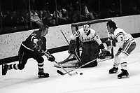 Seals vs Pittsburg Penguins 1975. Penguins,Stan Gilbertson, against Seals Mike Christie and goalie Gilles Meloche. (photo/Ron Riesterer)