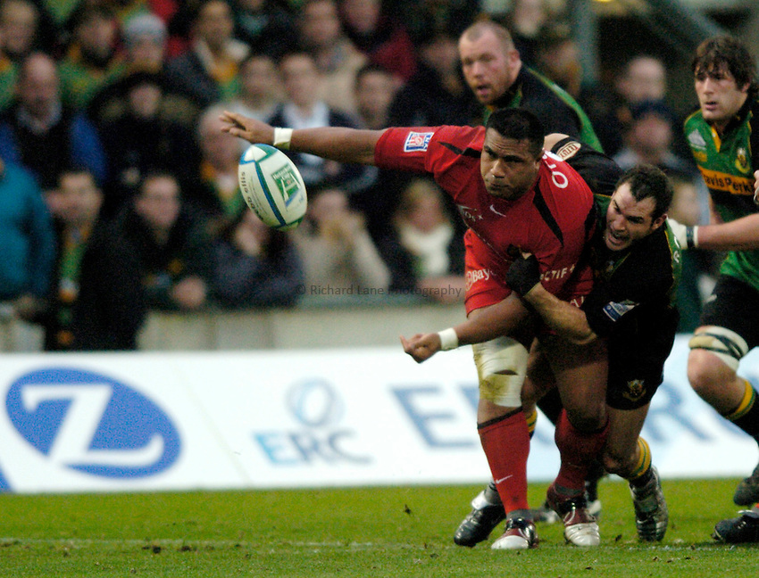 Photo: Richard Lane..Northampton Saints v Toulouse. Heineken Cup. 04/12/2004..Isitolo Maka is tackled by Mark Robinson.