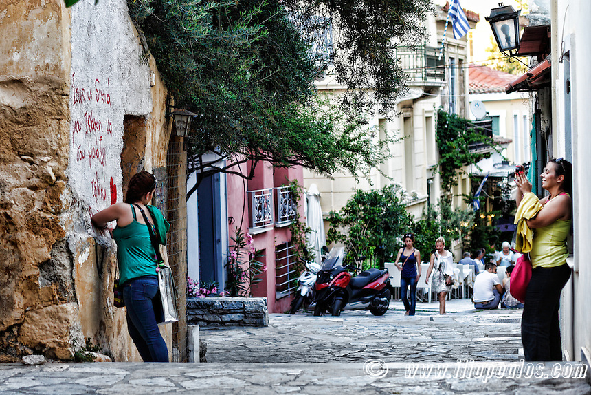 Taking pictures in the streets of Plaka, Greece