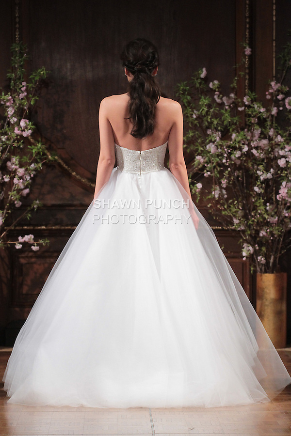 """Model walks runway in a """"Jackie"""" bridal gown from the Isabelle Armstrong Spring Collection 2017, at Lotte New York Palace Hotel, during New York Bridal Fashion Week Spring Summer 2017 on April 16, 2017."""
