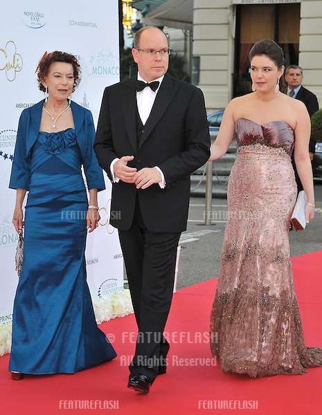 Prince Albert II of Monaco with Baroness Elisabeth-Anne de Massy & daughter Melanie Antoinette de Massy  at the inaugural Nights in Monaco Gala to benefit the Prince Albert II of Monaco Foundation and the William J. Clinton Foundation, at the Hotel de Paris, Monte Carlo..May 23, 2012  Monaco, France.Picture: Paul Smith / Featureflash