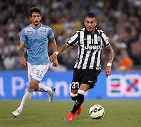 Calcio, finale Tim Cup: Juventus vs Lazio. Roma, stadio Olimpico, 20 maggio 2015.<br /> Juventus' Roberto Pereyra, right, is chased by Lazio's Danilo Cataldi during the Italian Cup final football match between Juventus and Lazio at Rome's Olympic stadium, 20 May 2015.<br /> UPDATE IMAGES PRESS/Isabella Bonotto