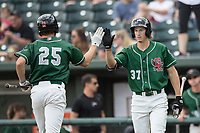 Great Lakes Loons outfielder Mitchell Hansen (37) greets teammate Cody Thomas (25) after he crosses the plate against the Bowling Green Hot Rods during the Midwest League baseball game on June 4, 2017 at Dow Diamond in Midland, Michigan. Great Lakes defeated Bowling Green 11-0. (Andrew Woolley/Four Seam Images)