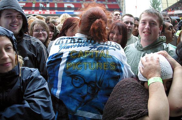 FANS.At the R.E.M. Concert, Nottingham Forrest FC, .Nottingham, 6th July 2005..half length back behind Mike Mills jacket rem.Ref: JEZ.www.capitalpictures.com.sales@capitalpictures.com.©Jez Self/Capital Pictures