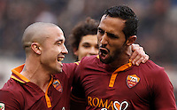 Calcio, Serie A: Roma-Genoa. Roma, stadio Olimpico, 12 gennaio 2014.<br /> AS Roma defender Mehdi Benatia, of Morocco, right, celebrates with teammate Radja Nainggolan, of Belgium,  after scoring during the Italian Serie A football match between AS Roma and Genoa, at Rome's Olympic stadium, 12 January 2014. <br /> UPDATE IMAGES PRESS/Isabella Bonotto