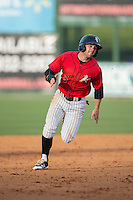 Tyler Sullivan (5) of the Kannapolis Intimidators hustles towards third base against the Hickory Crawdads at Kannapolis Intimidators Stadium on April 10, 2016 in Kannapolis, North Carolina.  The Intimidators defeated the Crawdads 10-3.  (Brian Westerholt/Four Seam Images)