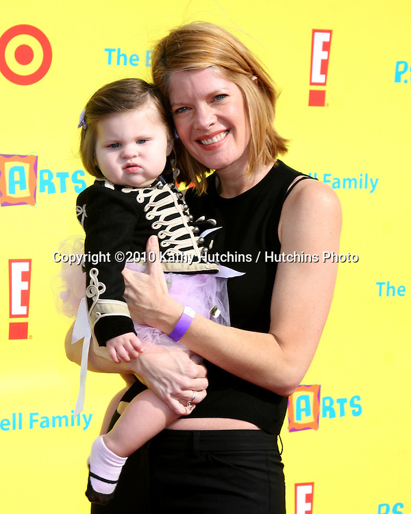 LOS ANGELES - NOV 7:  Michelle Stafford, daughter Natalia Stafford arrives at the PS Arts Express Yourself Event at Barker Hanger on November 7, 2010 in Santa Monica, CA