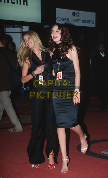 LEAH WOODS & ELIZABETH JAGGER ..MOBO Awards..Ref:11123..celeb friends, halter neck, passes..www.capitalpictures.com..sales@capitalpictures.com..©Capital Pictures..full length, full-length