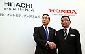 February 7, 2017, Tokyo, Japan - Japan's Honda Motor president Takahiro Hachigo (R) shakes hands with Japan's electronics giant Hitachi's auto parts subsidiary Hitachi Automotive Systems president Hideaki Seki as they agreed to form a joint venture to produce electric motors for vehicles at a press conference in Tokyo on Tuesday, February 7, 2017. The new electric vehicle motor company has plan to establish manufacture and sales bases subsidiaries in the United States and China.    (Photo by Yoshio Tsunoda/AFLO) LWX -ytd-
