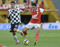 BOGOTÁ -COLOMBIA, 22-03-2014. Daniel Torres (Der.) jugador de Independiente Santa Fe disputa el balón con Javier Sanguinetti (Izq.) jugador de Boyaca Chico FC, durante partido por la fecha 12 de la Liga Postobon I-2014, jugado en el estadio Nemesio Camacho El Campin de la ciudad de Bogota. / Daniel Torres (R) jugador of Independiente Santa Fe vies for the ball with Javier Sanguinetti (L) player of Boyaca Chico FC during a match for the 12th date of the Liga Postobon I-2014 at the Nemesio Camacho El Campin Stadium in Bogota city. Photo: VizzorImage/ Gabriel Aponte / Staff