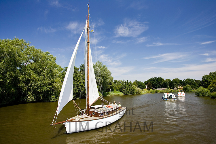 Sailing boat and motor cruisers on the Norfolk Broads, United Kingdom