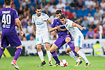 Marco Benassi (c) of ACF Fiorentina fights for the ball with Theo Hernandez (r) and Daniel Ceballos Fernandez, Dani Ceballos, of Real Madrid during the Santiago Bernabeu Trophy 2017 match between Real Madrid and ACF Fiorentina at the Santiago Bernabeu Stadium on 23 August 2017 in Madrid, Spain. Photo by Diego Gonzalez / Power Sport Images