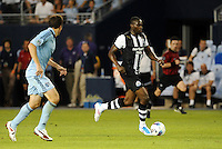 Shola Ameobi Newcastle United drives at the Sporting KC goal... Sporting Kansas City and Newcastle United played to a scoreless tie in an international friendly at LIVESTRONG Sporting Park, Kansas City, Kansas.