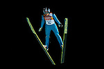 Dusty Korek of Canada jumps during the Men's Normal Hill Individual of the 2014 Sochi Olympic Winter Games at Russki Gorki Ski Juming Center on February 9, 2014 in Sochi, Russia. Photo by Victor Fraile / Power Sport Images