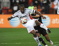 Washington D.C. - April 5, 2014: Jose Goncalves from the New England Revolution shield the ball against D. C. United Davy Arnaud.  D.C. United defeated 2-0 the New England Revolution during a Major League Soccer match for the 2014 season at RFK Stadium.
