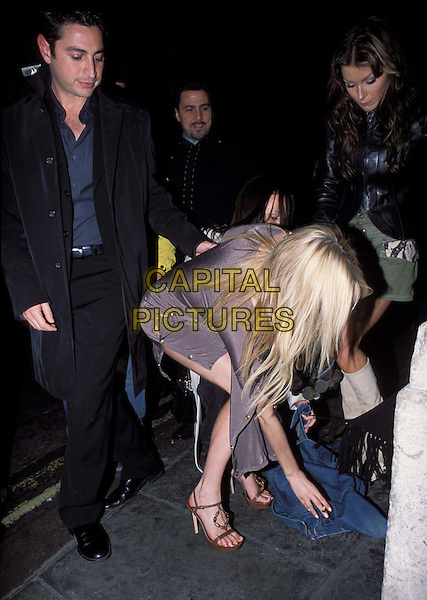 CAROLINE STANBURY.At Chinawhite Bar.www.capitalpictures.com.sales@capitalpictures.com.©Capital Pictures.funny, bending over