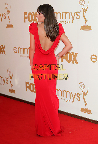 Lea Michele (wearing Marchesa).63rd Primetime Emmy Awards - Arrivals Held at The Nokia LA Live, Los Angeles, California, USA..September 18th, 2011.emmys full length dress red looking over shoulder cowel back behind rear looking over shoulder rosette detail shoulders.CAP/ADM/KB.©Kevan Brooks/AdMedia/Capital Pictures.