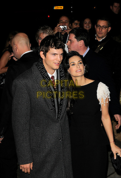 """ASHTON KUTCHER & DEMI MOORE.UK Film Premiere of """"Flawless"""" at the Odeon Covent Garden, London, England. .November 26th, 2008.half length black dress married husband wife grey gray coat jacket white sleeves beads beaded red string kaballah bracelet pattern scarf .CAP/CAN.©Can Nguyen/Capital Pictures."""