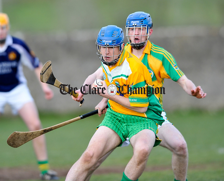 Sean Mc Conigley of Inagh-Kilnamona in action against Michael Mc Grath of Broadford-O Callaghan's Mills during their U-21 championship game at Tulla. Photograph by John Kelly.