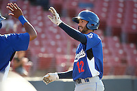 Michael Ahmed (12) of the Rancho Cucamonga Quakes is greeted by his teammates after hitting a home run against the High Desert Mavericks at Heritage Field on August 7, 2016 in Adelanto, California. Rancho Cucamonga defeated High Desert, 10-9. (Larry Goren/Four Seam Images)