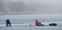 Three ice fishermen on Sarnia Bay, same day as the Bluewater Anglers cancel February ice fishing derby.